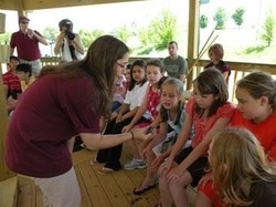 Educator with children at the Wetland Center